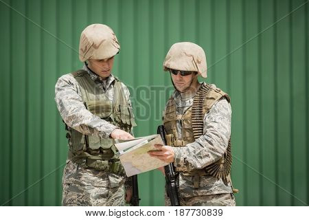 Soldiers having discussion over map in boot camp