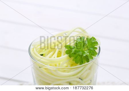 glass of raw zucchini noodles - close up