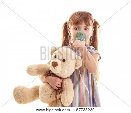Cute little girl using nebulizer on white background. Allergy concept