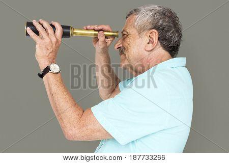 Senior Adult Man Looking Through Spyglass Telescope Studio Portrait
