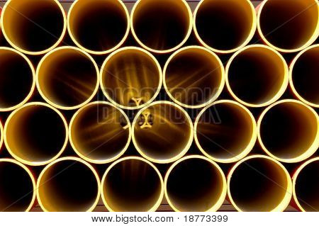 Golden metal pipes on a construction site