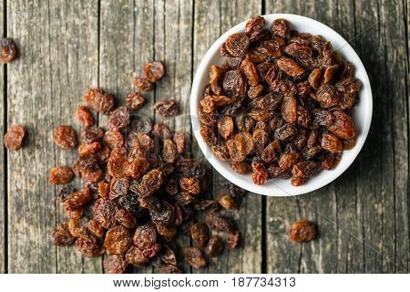 Sweet dried raisins in bowl. Top view.