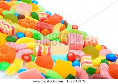 Tasty and colorful candies on white background
