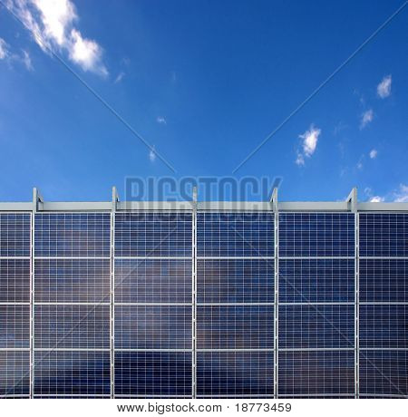 Solar energy panels and a blue sky