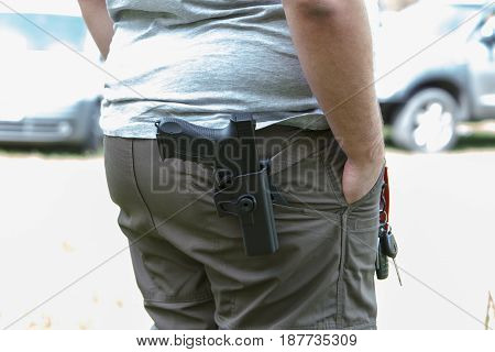 Pistol in the holster. The shooter trains. Is preparing to shoot at the target.