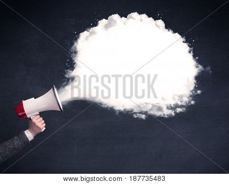 Caucasian business hand holding megaphone with white plain message cloud