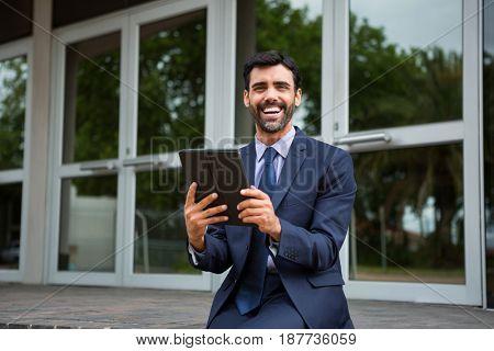Businessman using digital tablet in conference centre