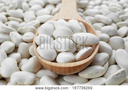 Wooden spoon with butter beans, closeup