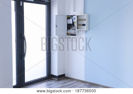 Distribution board with wires in light room near door