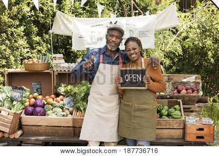 African couple owner fresh gracery organic shop