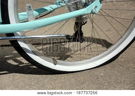 Closeup view of bicycle flat tire on pavement