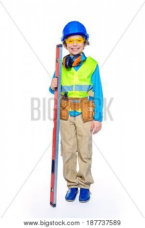 Portrait of a boy in a helmet playing builder with tools. Different occupations. Isolated over white background.