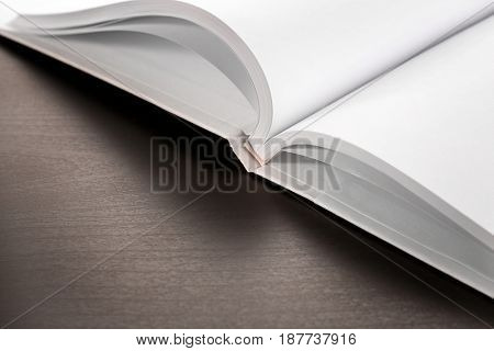 Blank pages of opened book on black background