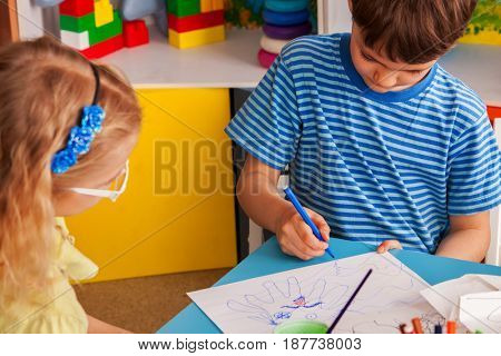 Small students painting in art school class. Children boy and girl drawing by paints on table. Children have fun together. Craft drawing education develops creative abilities of kids.