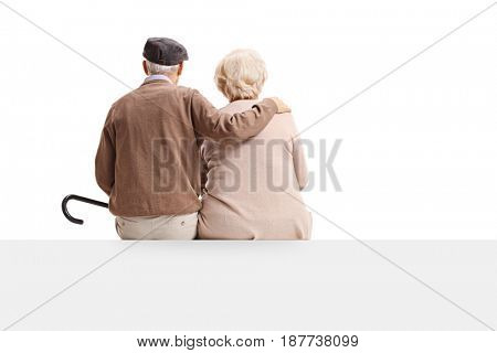 Rear view shot of a senior couple sitting on a panel isolated on white background