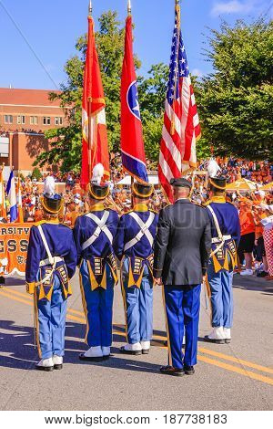Knoxville, TN, USA - 09/17/2016: Honor guard of the University of Tennessee carring the US State and UT flags at Neyland Stadium Knoxville TN
