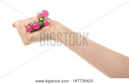 Female hand with stress ball on white background