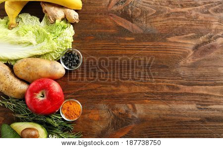 Set of healthy products on wooden background