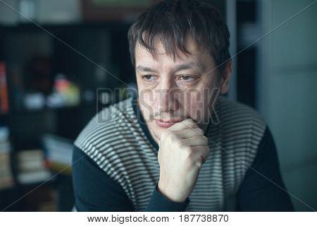 Sad man at home. Depression adult men