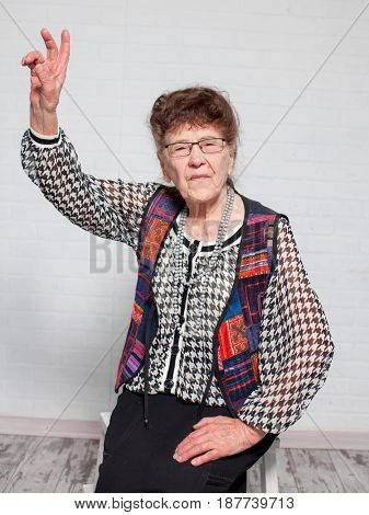 Elderly woman. Studio shot. Happy old female