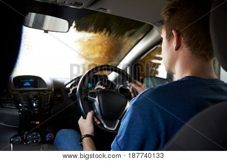 Motorist Driving Through Automated Car Wash