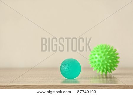 Two rubber balls on light background