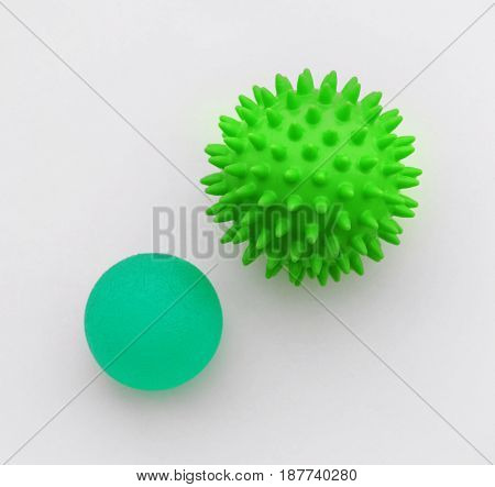 Two rubber balls on white background. Concept of physiotherapy