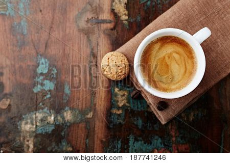 Cup of Coffee with Biscotti on an Old Wooden Table