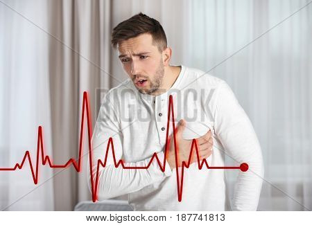 Heart attack concept. Man suffering from chest pain indoor