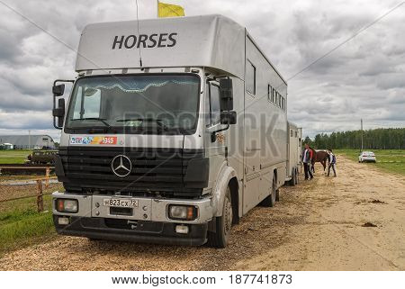 Tyumen, Russia - June 25, 2016: The 5th open championship of Russia on a plowed land. Horse van for animal transportation at hippodrome