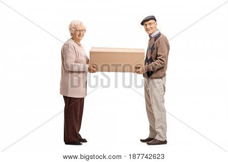 Full length portrait of an elderly man and woman holding a big cardboard box isolated on white background