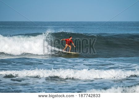 Man surfs in the ocean