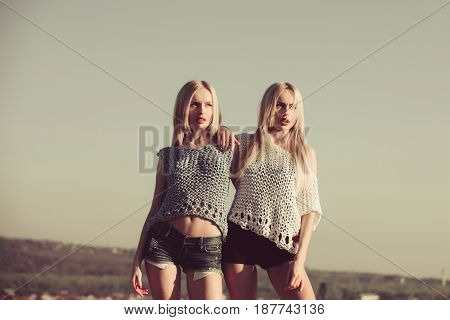 Women Posing On Sunny Day On Blue Sky