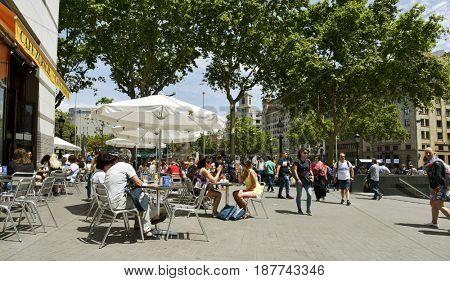 BARCELONA, SPAIN - MAY 22, 2017: Ambiance at the terrace of Cafe Zurich, next to Placa de Catalunya in Barcelona, Spain. This popular cafe, opened in 1862, was demolished and rebuilt in the same place