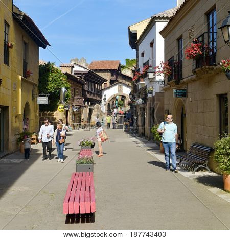 BARCELONA, SPAIN - MAY 20, 2017: People visiting the Poble Espanyol in Barcelona, Spain. This open-air museum recreates different Spanish buildings and was built for the 1929 International Exposition