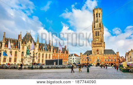 Market Square (Markt) Provincial government in Bruges, Belgium. View to Belfort tower building in historical centre of old town day panorama with blue sky and clouds.