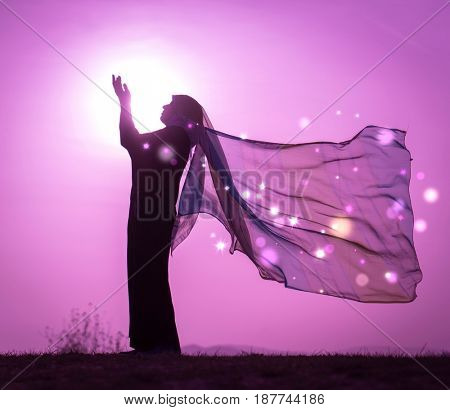 Copy space of silhouette woman rising hands on sunset sky double exposure colorful bokeh and bird fly background. Vintage tone filter effect color style.