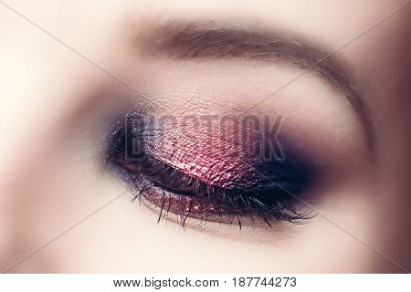 Glamour makeup nad perfect eyebrow close-up. Beauty industry concept. Cat eye look.