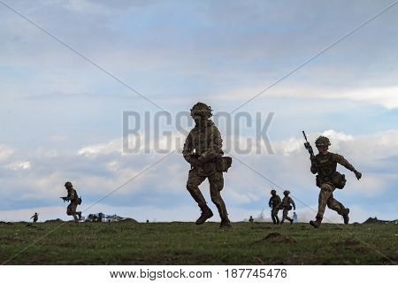 British army personnel take part in the NATO 'Wind Spring 15' military exercise at Smardan military shooting range, in Romania on April 22, 2015.