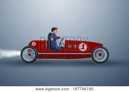 Businessman driving car in competition concept