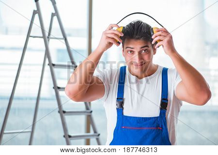 Worker with noise cancelling headphones