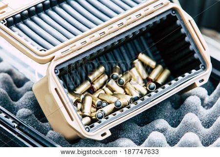 Bullets for the gun in a plastic box.