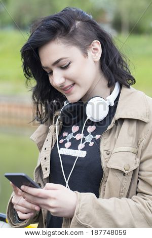 Young Beautiful Woman Hipster Texting Messages