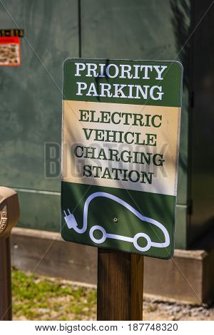 Nashville, TN, USA - 04/04/2016: Priority Parking - Electric vehicle charging station sign outside a Cafe near Nashville TN