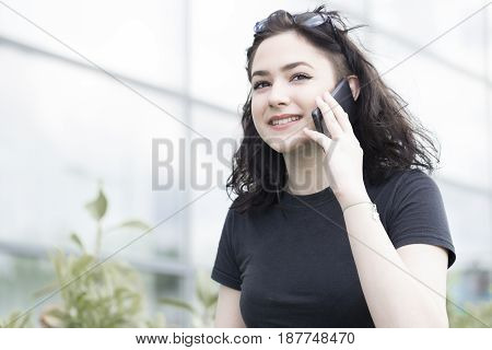 Young Smiling Woman Talking On A Mobile Phone