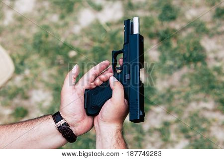 Recharge the gun in hand. Training on shooting.