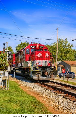Midway, KY, USA - 09/14/2016: Railroad locomotive of the Central Kentucky Lines passing through downtown Midway part of the Lexington-Fayette area of Kentucky