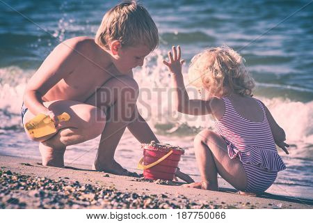Happy Children Playing With Toys And Sand. Instagram Stylisation