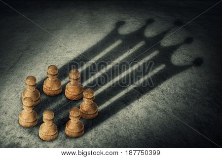 Chess pawn standing together arranged in a circle joining the power casting a crown shaped shadow. Business group leadership and team working concept. Belief in success.