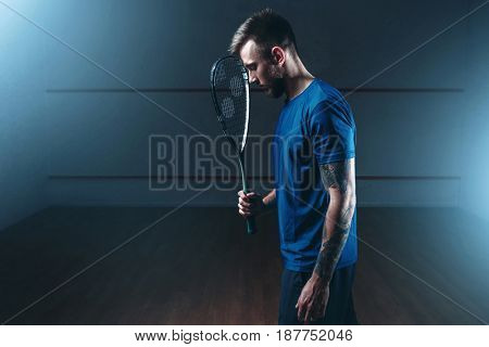 Squash game concept, male player with racket